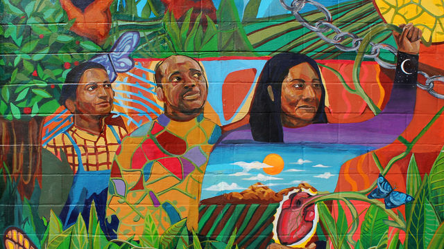 This mural detail features farm workers standing in solidarity.