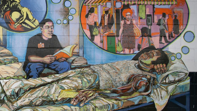 This mural detail features a young incarcerated man daydreaming about the future after his release.