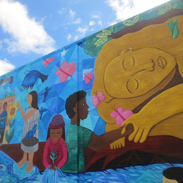Mural detail highlights a young people celebrating.